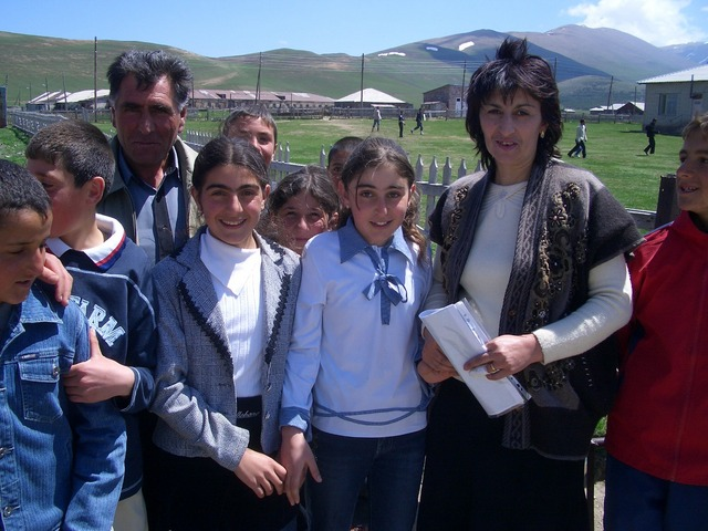 Ms. Torosjan, husband and students