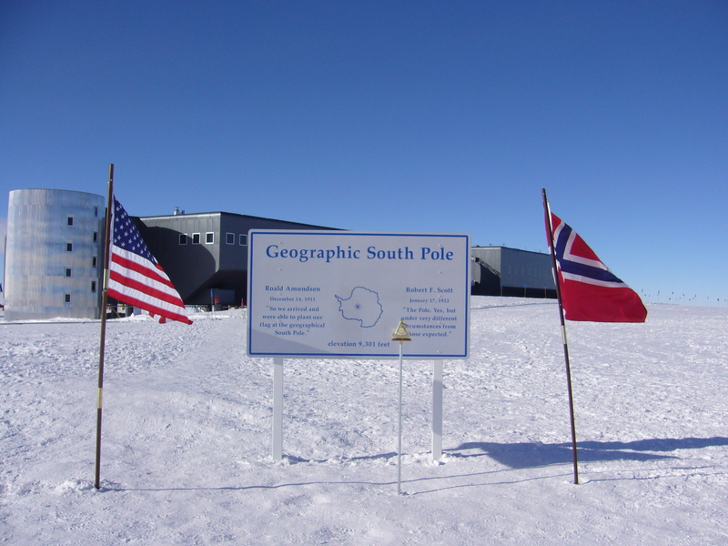 Official South Pole marker (as of 2011) and the Amundsen-Scott South Pole Station