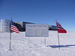 #1: Official South Pole marker (as of 2011) and the Amundsen-Scott South Pole Station