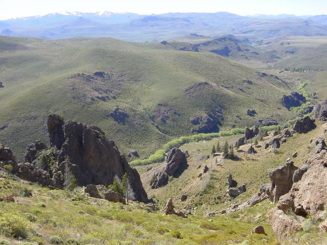 From part way up the mountain, view northwest of stream flowing into Limay River