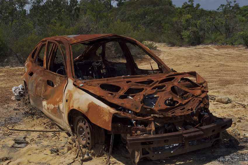 A wrecked, burned-out car, near the confluence point