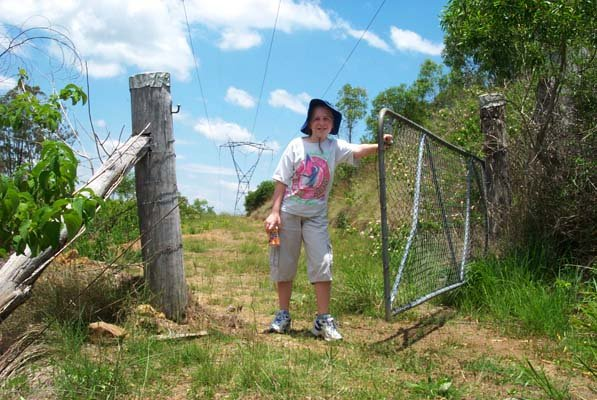 Lissa opens a gate on the powerline track