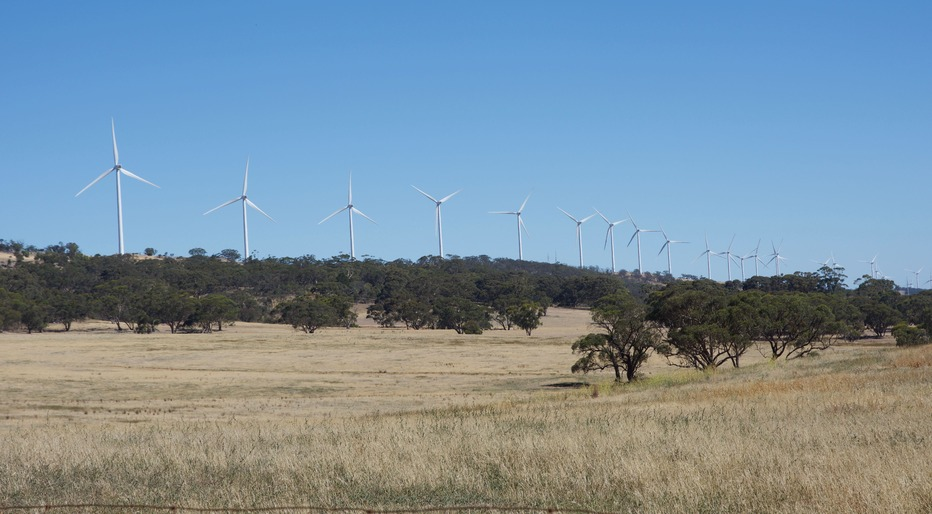 A line of wind turbines, passed en route to the point