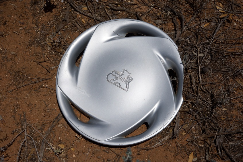 A hub cap from a Holden car, laying very close to the point