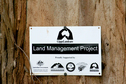 #9: Land Management Project sign showing sponsors.