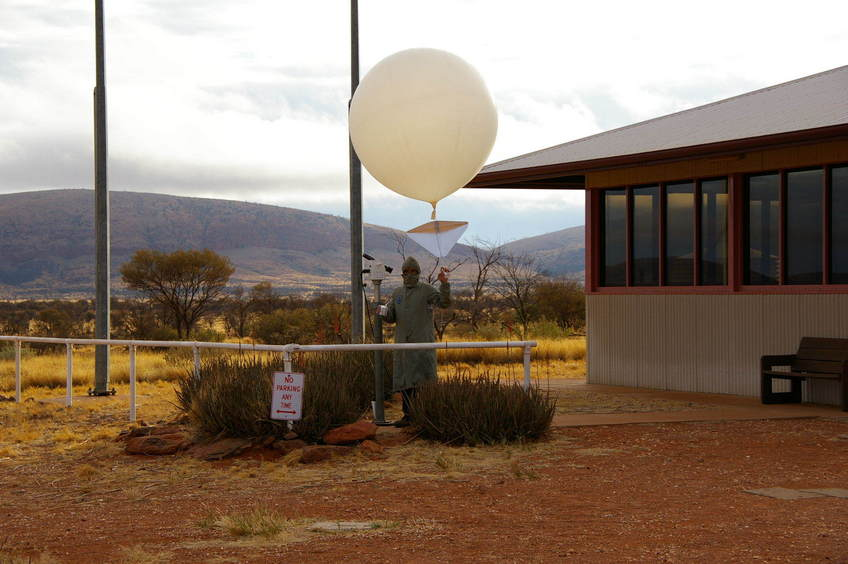 Launching a weather balloon at Australian Most Remote Weather Station at Giles