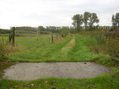#9: Fenced area with a stonebridge in the foregound