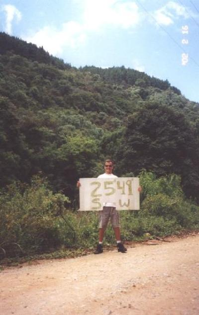 Me at the confluence with the banner