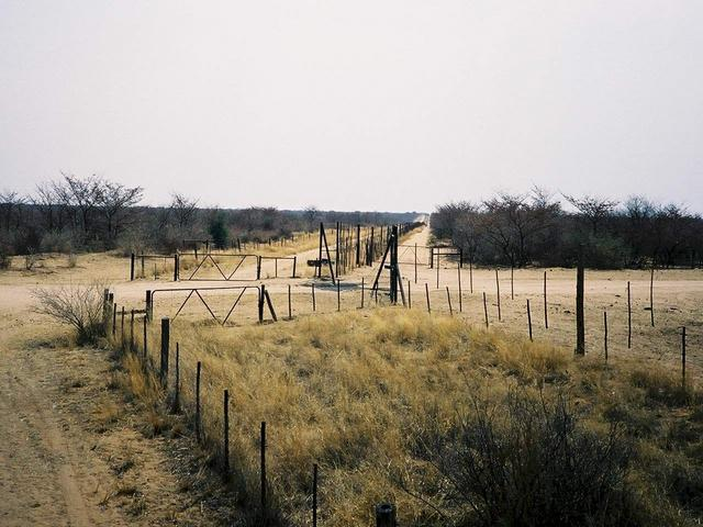 Road passing border fence