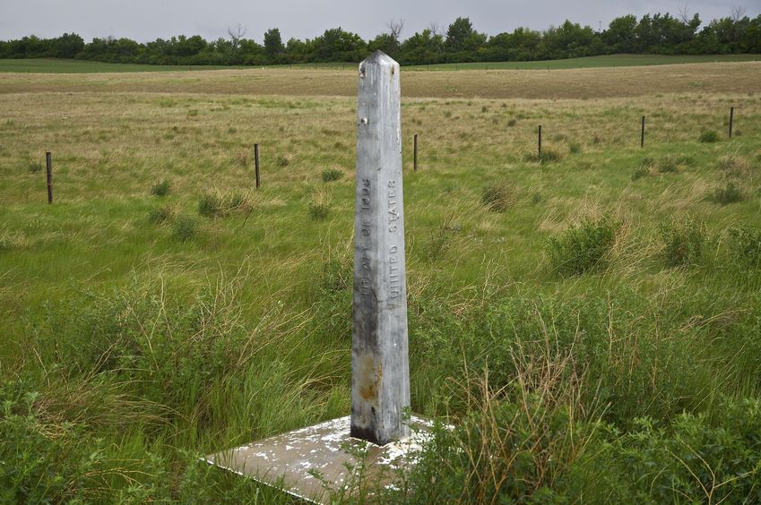 The U.S.-Canada border marker, just east of the confluence point, at [48.9986,-111.9953]