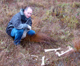 #10: Todd looks at moose bones.