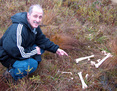 #9: Frank looks at moose bones found on the way to the confluence point.