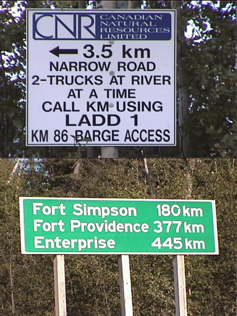 barge access sign, and signpost at kilometer 140 marker