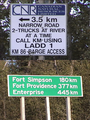 #7: barge access sign, and signpost at kilometer 140 marker