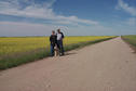 #5: Carolyn, Max and Alan in front of a canola (aka rape) field.
