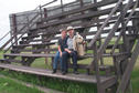 #5: Carolyn, Alan and Max on the bleachers on the Vanscoy rodeo grounds.