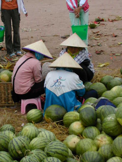 Watermelons and conical hats at the market on the way to the confluence