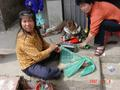 #10: Womenfolk sitting outside their homes weaving nets