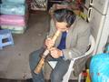 #9: Practitioner demonstrates the art of smoking a bamboo bong.