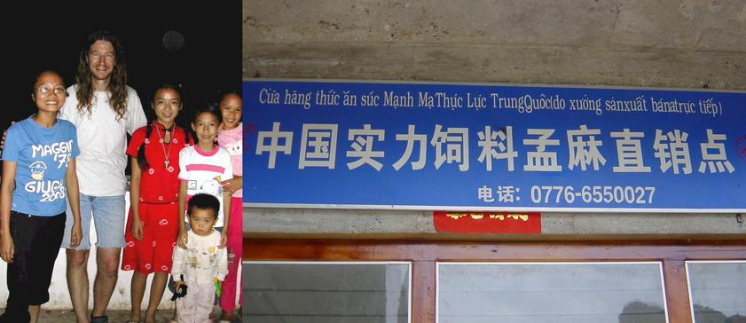 Welcoming committee posing with Targ and Sign in Mengma in both Chinese and Vietnamese