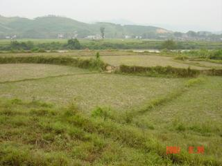 #1: Facing north-northwest; confluence in centre foreground field, river beyond; expressway on distant hillside.