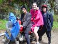 #2: Two motorcyclists who took us to Xiao'aiping, and Tony kitted out in his brand new bright pink raincoat