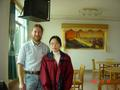 "#2: Jiang Cuiwen (""Man""), and a rather dishevelled me, in the restaurant in Jiangkou"