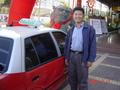 #2: The taxi driver who took me from Zhangzhou to Longyan, outside the entrance to the Houston Hotel