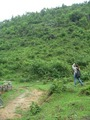 #10: Ah Feng standing near the good path, taking a photo of the slope on which the confluence is located.