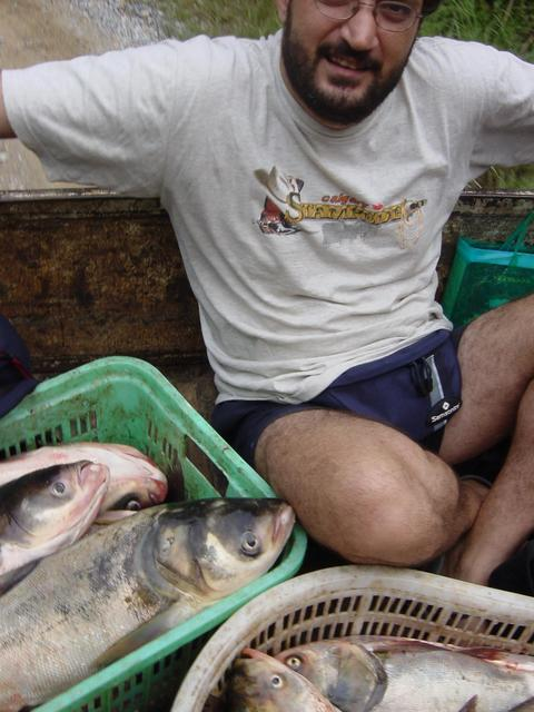 Tony wedged into back of truck carrying fish to market in Ansha (Peaceful Sand)