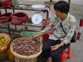 #2: Roadside vendor in Yongtai selling (and eating) dried persimmons.