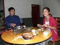 #3: Lǐ Qíjīn and Ah Feng at dinner.