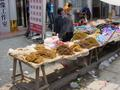 #3: Plastic shoe stall alongside a tobacco stall in Pingkou