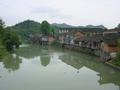 "#2: Picturesque town of Niuchehe (""Ox Cart River""), dominated by the river that flows right through the middle of it"