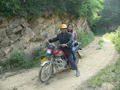 #6: Motorcyclist and Ah Feng on the dirt road.
