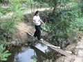 #6: Ah Feng crossing the stream on a tiny bridge