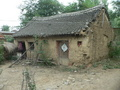 #4: Mud house in the village where we turned left onto a dirt road