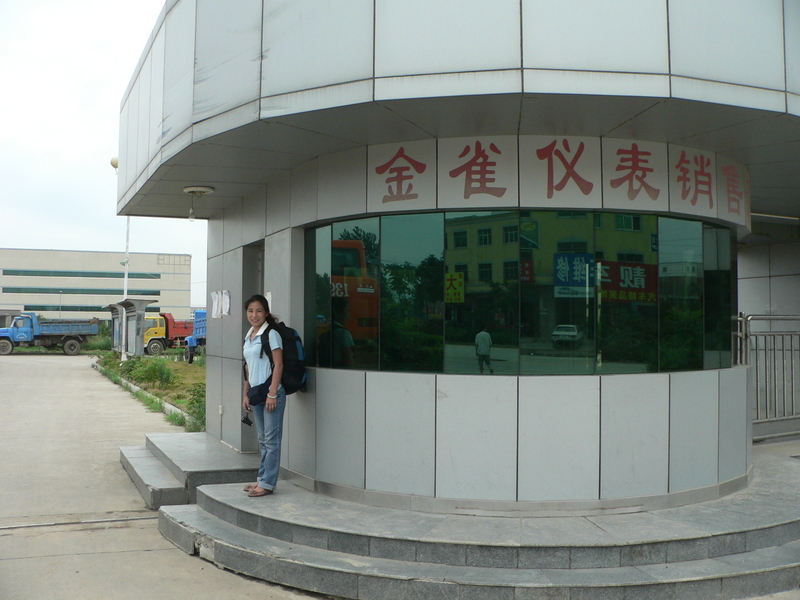 Ah Feng at the guard station in front of the factory