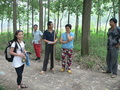 #10: Ah Feng with interested onlookers; Liú Xùmíng in the centre, holding the shoulder pole