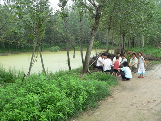 #1: Locals playing mahjong next to the confluence pond