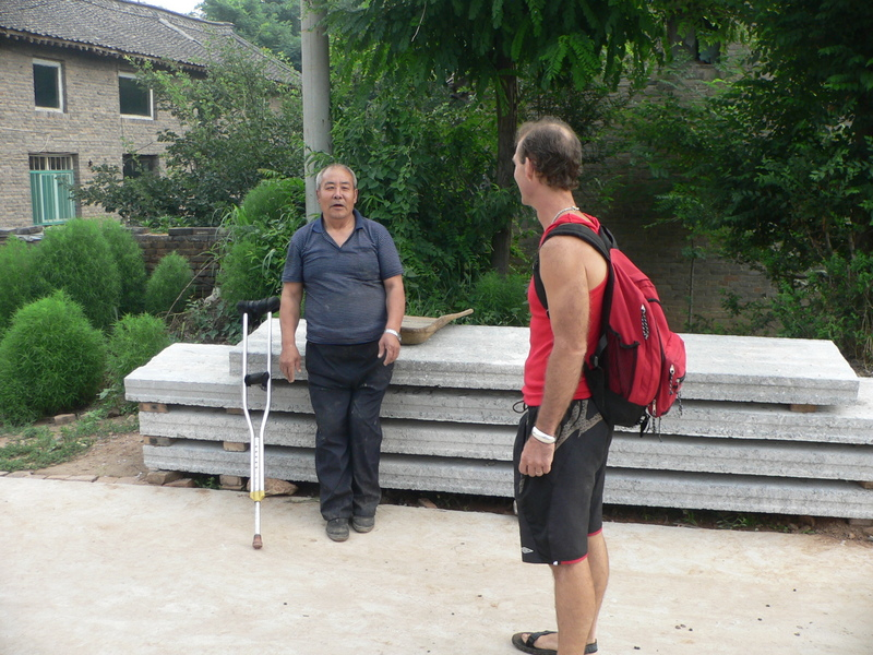 Peter chats with a friendly local in Huanghou Village