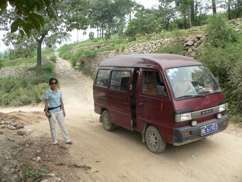 Ah Feng and our minivan, at the intersection with the small gravel road we should have gone down