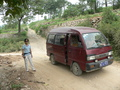 #8: Ah Feng and our minivan, at the intersection with the small gravel road we should have gone down