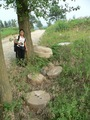 #2: Ah Feng and some abandoned millstones beside the road leading to the confluence