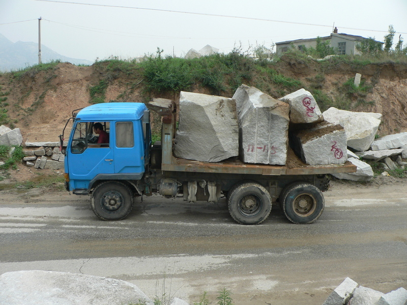 Truck carrying large chunks of rock