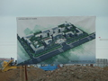 #4: Sign depicting future factory development, with work going on behind