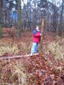 #2: Erika at the confluence point - note fluorescent writing (50,9) on logs