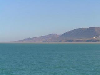 #1: View ENE - The coast around Cap Ouillis seen from the Confluence