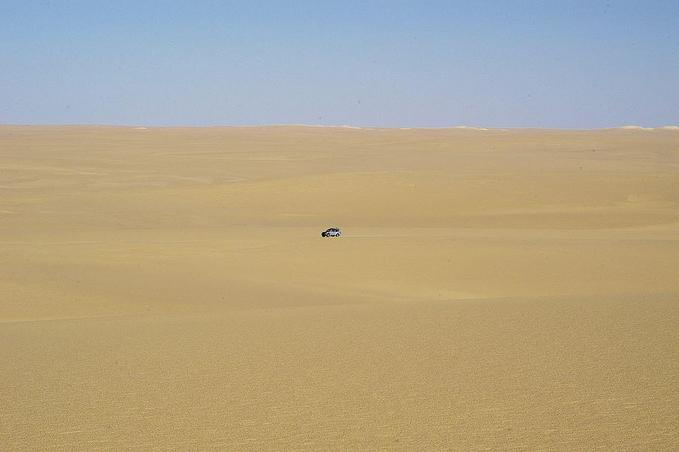 View of the confluence area. Due to only sand dunes and harsh daylight, I took the scene with one car