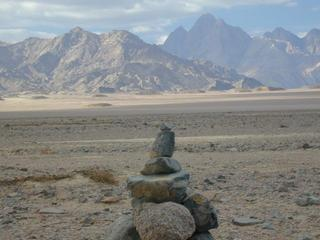 #1: Looking at Jabal Ġarīb located to the NW over the cairn we created at the DC.